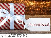 Купить «Atmospheric Christmas Gift With Label, Adventszeit Means Advent Season», фото № 27975943, снято 26 мая 2019 г. (c) PantherMedia / Фотобанк Лори