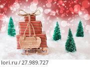 Купить «Sleigh On Red Background, Merry Christmas And Happy New Year», фото № 27989727, снято 26 марта 2019 г. (c) PantherMedia / Фотобанк Лори