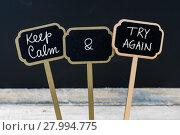 Купить «Keep Calm and Try Again message written with chalk on mini blackboard labels», фото № 27994775, снято 18 июля 2019 г. (c) PantherMedia / Фотобанк Лори