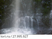 Купить «Waterfall coming down on the rocks», фото № 27995927, снято 21 мая 2019 г. (c) PantherMedia / Фотобанк Лори