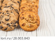 Купить «Biscuits with chocolate and peanut on old wooden table.», фото № 28003843, снято 25 мая 2018 г. (c) PantherMedia / Фотобанк Лори