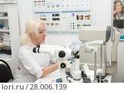 Купить «Optometrist doctor in his workplace», фото № 28006139, снято 13 февраля 2018 г. (c) Юлия Бабкина / Фотобанк Лори