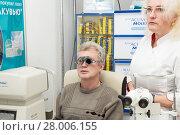 Купить «Man in optometric clinic, vision check», фото № 28006155, снято 13 февраля 2018 г. (c) Юлия Бабкина / Фотобанк Лори
