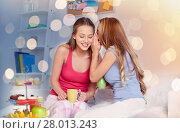 Купить «young women drinking tea and gossiping at home», фото № 28013243, снято 14 ноября 2015 г. (c) Syda Productions / Фотобанк Лори