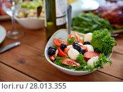 Купить «vegetable salad with mozzarella on wooden table», фото № 28013355, снято 5 октября 2017 г. (c) Syda Productions / Фотобанк Лори