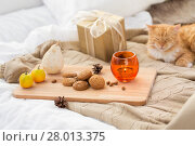 Купить «oatmeal cookies, christmas gift and candle in bed», фото № 28013375, снято 15 ноября 2017 г. (c) Syda Productions / Фотобанк Лори
