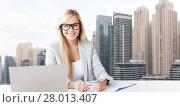 Купить «businesswoman with notepad and laptop at office», фото № 28013407, снято 30 марта 2013 г. (c) Syda Productions / Фотобанк Лори