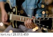 Купить «close up of man playing guitar at studio rehearsal», фото № 28013459, снято 18 августа 2016 г. (c) Syda Productions / Фотобанк Лори