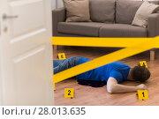 Купить «dead man body in blood on floor at crime scene», фото № 28013635, снято 5 мая 2017 г. (c) Syda Productions / Фотобанк Лори