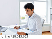 Купить «businessman working with papers at office», фото № 28013663, снято 12 октября 2017 г. (c) Syda Productions / Фотобанк Лори