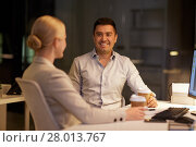 Купить «business people drinking coffee at night office», фото № 28013767, снято 6 декабря 2017 г. (c) Syda Productions / Фотобанк Лори
