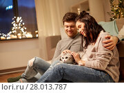 Купить «happy couple with cat at home», фото № 28013787, снято 13 января 2018 г. (c) Syda Productions / Фотобанк Лори