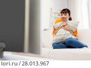 Купить «stunned asian woman with watching tv at home», фото № 28013967, снято 9 марта 2016 г. (c) Syda Productions / Фотобанк Лори