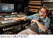Купить «man at mixing console in music recording studio», фото № 28014027, снято 18 августа 2016 г. (c) Syda Productions / Фотобанк Лори