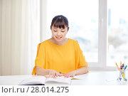 Купить «happy asian young woman student learning at home», фото № 28014275, снято 9 марта 2016 г. (c) Syda Productions / Фотобанк Лори
