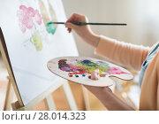 Купить «artist with palette painting at art studio», фото № 28014323, снято 1 июня 2017 г. (c) Syda Productions / Фотобанк Лори