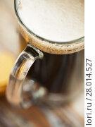 Купить «close up of dark draft beer glass mug», фото № 28014527, снято 31 января 2018 г. (c) Syda Productions / Фотобанк Лори
