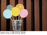 Купить «Five lollipops stacked in a metal pot», фото № 28015359, снято 24 февраля 2018 г. (c) PantherMedia / Фотобанк Лори