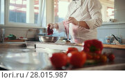 Chef prepares a salad by adding beets, vegetables in the foreground. Стоковое видео, видеограф Константин Шишкин / Фотобанк Лори