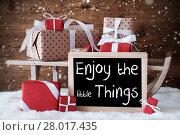 Купить «Sleigh With Gifts, Snow, Snowflakes, Quote Enjoy The Little Things», фото № 28017435, снято 20 июля 2018 г. (c) PantherMedia / Фотобанк Лори