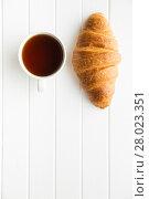 Купить «Tasty buttery croissant and cup of tea.», фото № 28023351, снято 20 февраля 2018 г. (c) PantherMedia / Фотобанк Лори