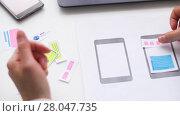 Купить «woman working on smartphone interface design», видеоролик № 28047735, снято 10 февраля 2018 г. (c) Syda Productions / Фотобанк Лори