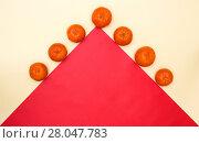 Купить «Абстрактный натюрморт с мандаринами и красным треугольником», фото № 28047783, снято 17 февраля 2018 г. (c) V.Ivantsov / Фотобанк Лори