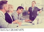 Купить «Businesswoman explaining to workgroup plans», фото № 28047875, снято 1 июля 2017 г. (c) Яков Филимонов / Фотобанк Лори