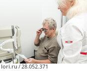 Купить «Woman optometrist checks vision for mature man», фото № 28052371, снято 13 февраля 2018 г. (c) Юлия Бабкина / Фотобанк Лори