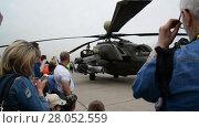 Купить «Zhukovsky, Russia - July 24. 2017. Russian heavy multipurpose transport helicopter Mi 26 at international aerospace show MAKS 2017», видеоролик № 28052559, снято 22 июля 2017 г. (c) Володина Ольга / Фотобанк Лори