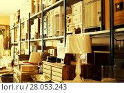 Купить «Wide range of vintage furniture in shop», фото № 28053243, снято 9 ноября 2017 г. (c) Яков Филимонов / Фотобанк Лори