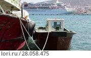 Купить «TURKEY - JULY 27, 2013: Tugboat moored in Kusadasi seaport. TURKEY. July 27, 2013», видеоролик № 28058475, снято 27 июля 2013 г. (c) Алексей Кузнецов / Фотобанк Лори
