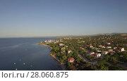 Купить «Coastal town scene with blue sea. Aerial view of Trikorfo Beach, Greece», видеоролик № 28060875, снято 25 апреля 2018 г. (c) Данил Руденко / Фотобанк Лори