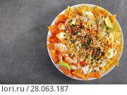 Купить «crispy loaded nachos on a plate», фото № 28063187, снято 19 февраля 2018 г. (c) Oksana Zh / Фотобанк Лори