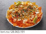 Купить «close-up of loaded nachos on plate», фото № 28063191, снято 19 февраля 2018 г. (c) Oksana Zh / Фотобанк Лори