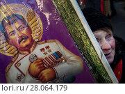 Женщина держит портрет Иосифа Виссарионовича Сталина во время марша и митинга КПРФ, посвященного 100-й годовщине Красной армии на Страстном бульваре в центре города Москвы, Россия, 23 февраля 2018. Редакционное фото, фотограф Николай Винокуров / Фотобанк Лори