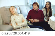 Купить «Portrait of upset little girl scolded by mother and grandma at home», видеоролик № 28064419, снято 27 ноября 2017 г. (c) Яков Филимонов / Фотобанк Лори