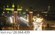 Купить «New Year celebrations with city lights at Placa Espana in Barcelona», видеоролик № 28064439, снято 6 января 2017 г. (c) Яков Филимонов / Фотобанк Лори