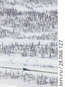 Купить «Clearing the road from the snow in the tundra, top view», фото № 28068127, снято 12 апреля 2017 г. (c) Владимир Мельников / Фотобанк Лори