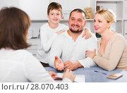 Купить «Happy family meeting financial adviser», фото № 28070403, снято 12 ноября 2017 г. (c) Яков Филимонов / Фотобанк Лори