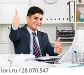 Купить «Male manager is having productive day at work», фото № 28070547, снято 18 мая 2017 г. (c) Яков Филимонов / Фотобанк Лори