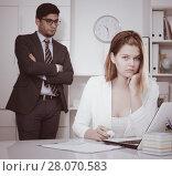 Купить «Frustrated business woman with angry chief», фото № 28070583, снято 1 июня 2017 г. (c) Яков Филимонов / Фотобанк Лори