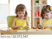 Купить «Children play educational toys in kindergarten», фото № 28073547, снято 19 сентября 2018 г. (c) Оксана Кузьмина / Фотобанк Лори
