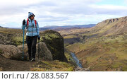 Купить «Young woman tourist practicing nordic walking in nature of Iceland, she is using hiking poles», видеоролик № 28083567, снято 25 октября 2017 г. (c) Алексей Кузнецов / Фотобанк Лори