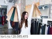 Купить «girl buyer with packs delighted from purchases», фото № 28085415, снято 17 января 2018 г. (c) Яков Филимонов / Фотобанк Лори