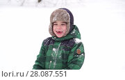 Купить «Beautiful Joyful preschooler boy having fun with snow. Winter wonderland», видеоролик № 28087551, снято 5 февраля 2018 г. (c) Ирина Мойсеева / Фотобанк Лори