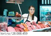 Купить «Female seller offering wursts», фото № 28088459, снято 25 марта 2019 г. (c) Яков Филимонов / Фотобанк Лори