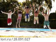 Купить «Rear View Of Children Jumping Into Outdoor Swimming Pool», фото № 28091027, снято 20 июля 2016 г. (c) easy Fotostock / Фотобанк Лори