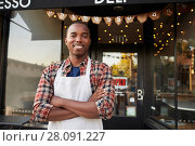 Купить «Black male business owner standing outside coffee shop», фото № 28091227, снято 31 августа 2016 г. (c) easy Fotostock / Фотобанк Лори