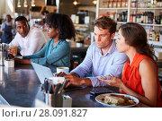 Купить «Group Enjoying Business Lunch At Delicatessen Counter», фото № 28091827, снято 2 сентября 2016 г. (c) easy Fotostock / Фотобанк Лори
